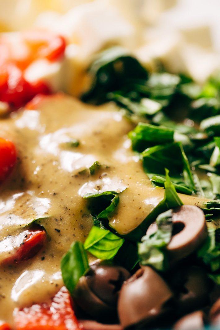 Roasted Garlic Italian Couscous Salad - made with homemade roasted garlic Italian dressing and tons of yummy salad toppings! Perfect for potlucks or picnics! #couscoussalad #italiansalad #salad #picnic #potluck #italiansalad   Littlespicejar.com