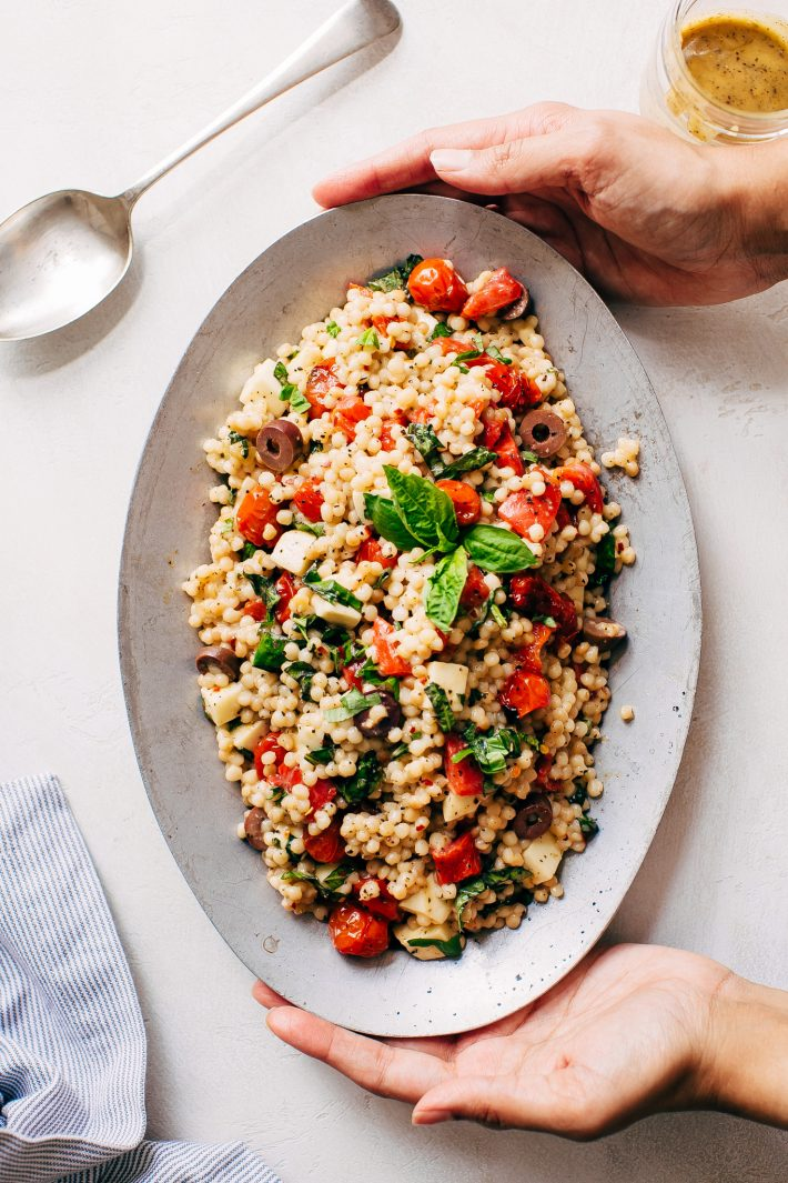 Roasted Garlic Italian Couscous Salad - made with homemade roasted garlic Italian dressing and tons of yummy salad toppings! Perfect for potlucks or picnics! #couscoussalad #italiansalad #salad #picnic #potluck #italiansalad | Littlespicejar.com