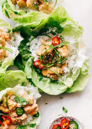 Bang Bang Chicken Lettuce Wraps - a homemade lettuce wrap stuffed with jasmine rice, sautéed chicken and tons of bang bang sauce! #bangbangchicken #bangbangsauce #bangbanglettucewraps #chickenlettucewraps | Littlespicejar.com