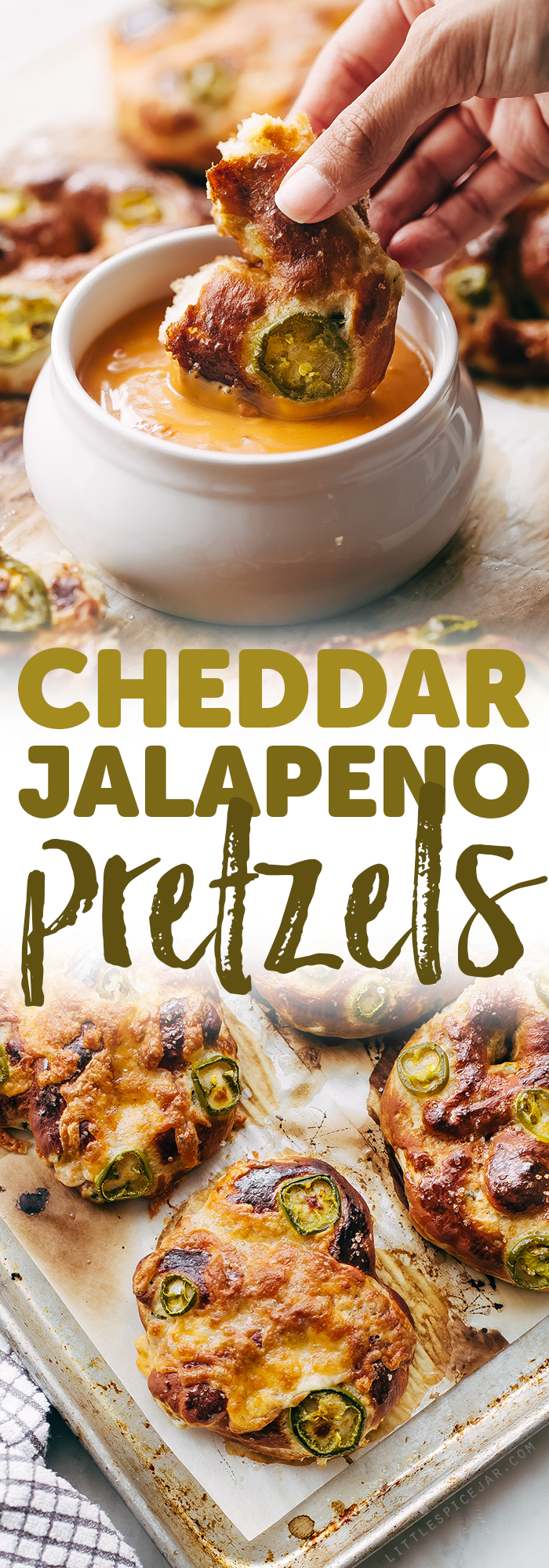 Cheddar Jalapeño Soft Pretzels - made with simple ingredients and loaded with tamed jalapeños and tons of cheddar cheese on top! So good you'll crave them ALL THE TIME! #softpretzels #jalapeñopretzels #jalapenosoftpretzels #softpretzelrecipe | Littlespicejar.com