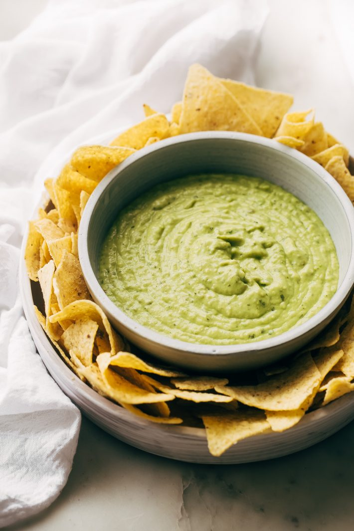 Creamy Guacamole Salsa - An easy avocado dip that tastes just like Mama Ninfa's Green Sauce. Serve with chips or dollop on tacos! #greensauce #mamaninfas #avocadodip #guacamolesalsa | Littlespicejar.com