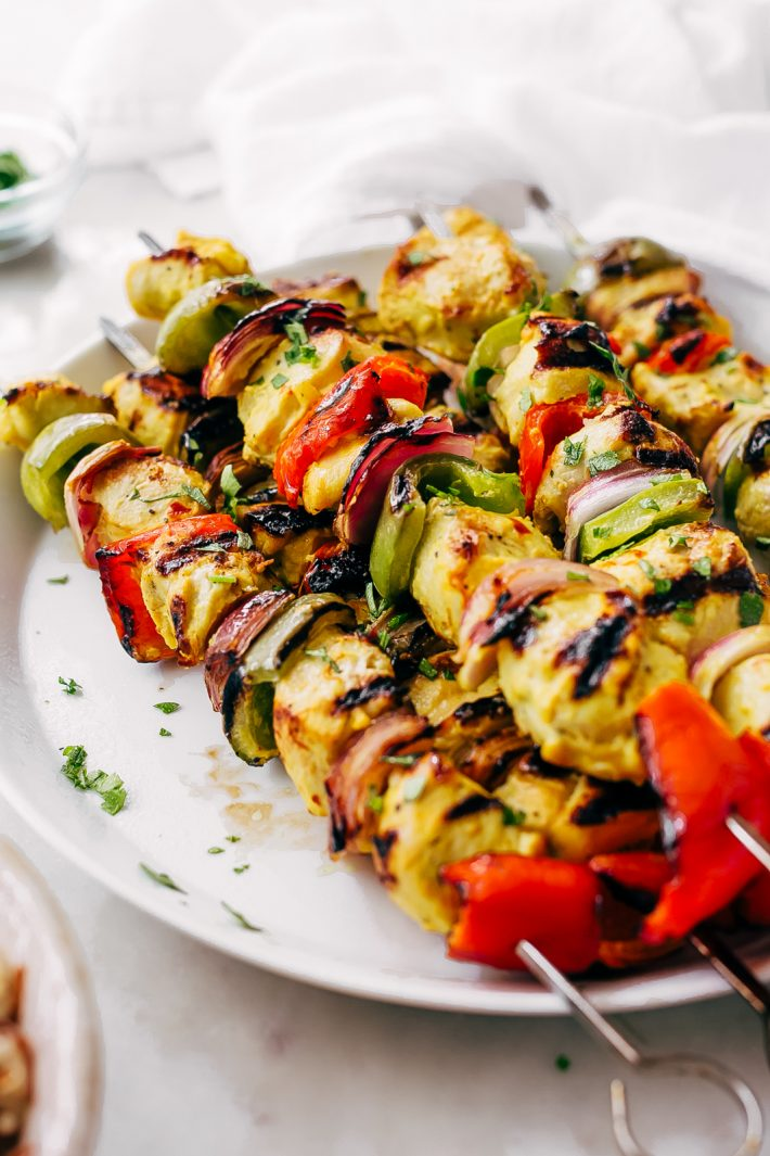 Easy Persian Chicken Kebabs - marinated in one secret ingredient that makes the chicken so tender it just melts in your mouth! #chickenkebabs #shishkebabs #persianchickenkebabs #jujehchicken | Littlespicejar.com