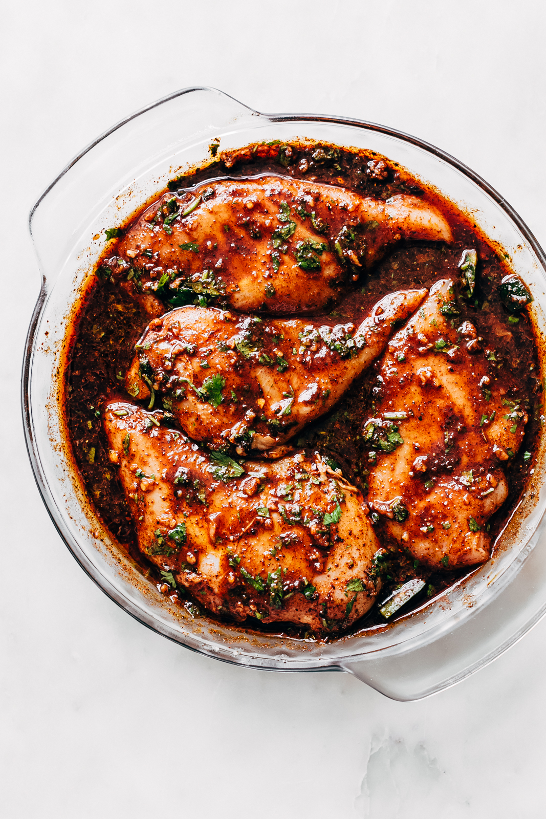 marinated chicken in round glass baking dish