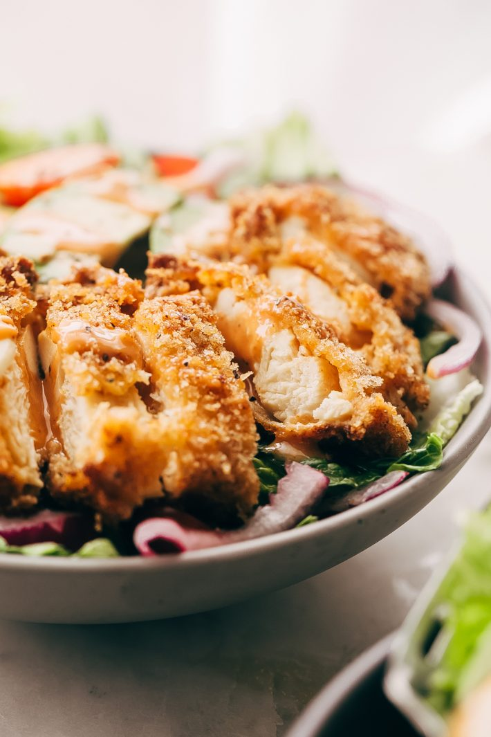 Crispy Chicken Salad with Sriracha Honey BBQ Dressing - homemade crispy chicken tenders tossed with all your favorite salad toppings and drizzled with homemade sriracha honey bbq dressing! So good it's sure to become a family favorite! #crispychickensalad #chickfilasauce #honeybbqchickensalad #salad | Littlespicejar.com