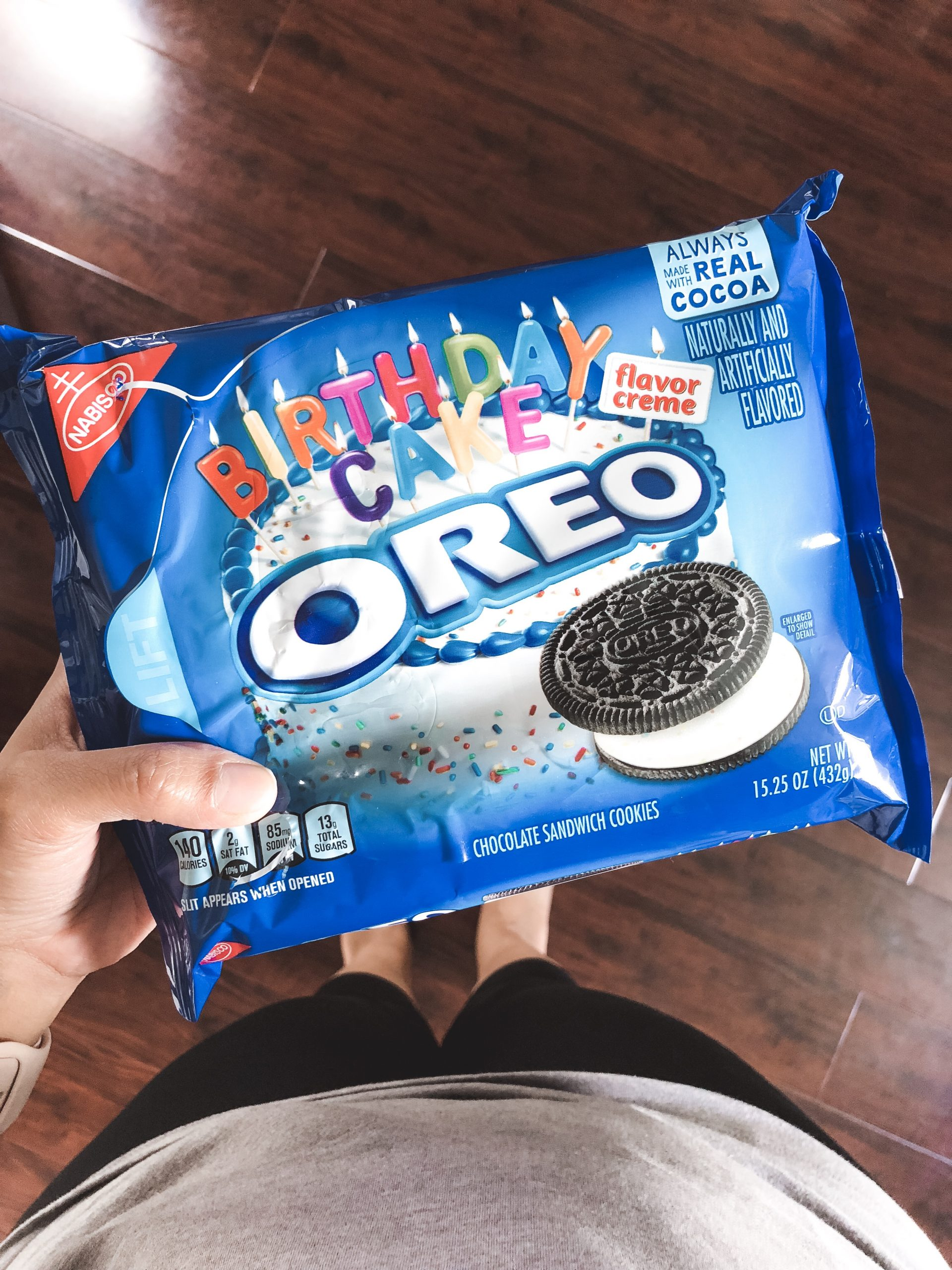 hand holding birthday cake Oreo in package