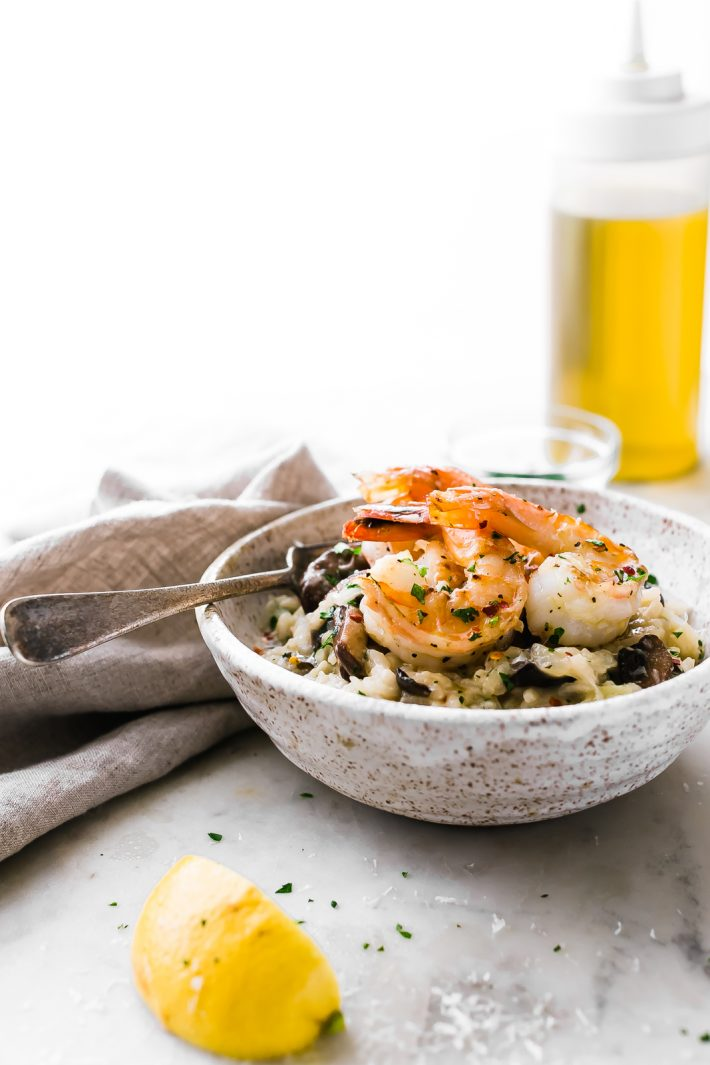 Mushroom Parmesan Shrimp Risotto - Learn how to make shrimp risotto at home with ease! Loaded with sautéed mushrooms, shrimp and tons of garlic! #shrimprisotto #mushroomrisotto #parmesanrisotto #homemaderisotto | Littlespicejar.com