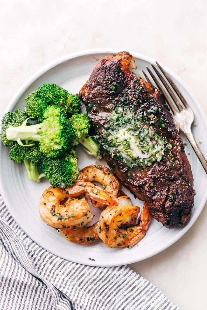 Garlic Butter Skillet Steak and Shrimp - tender cooked steak and juicy shrimp all smeared with homemade garlic butter. So easy to make and perfect for date night or even a weeknight dinner! #steakandshrimp #surfandturf #skilletsteak #pansearedsteak | Littlespicejar.com