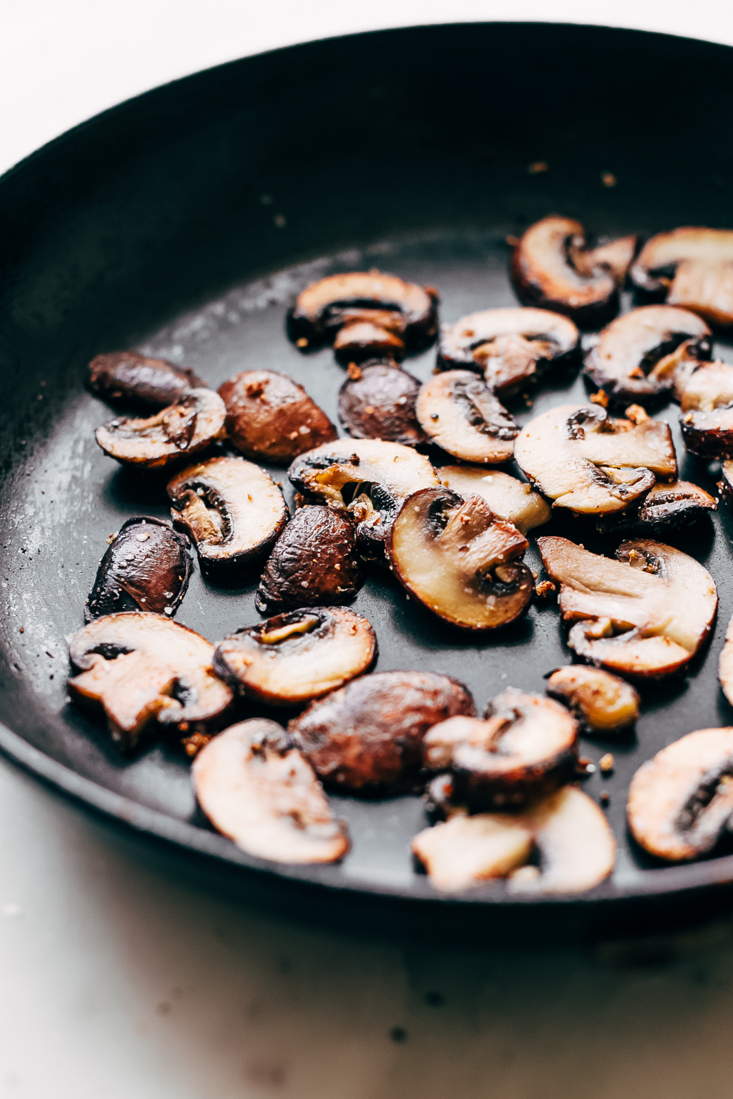 sautéed criminology mushrooms in frying pan
