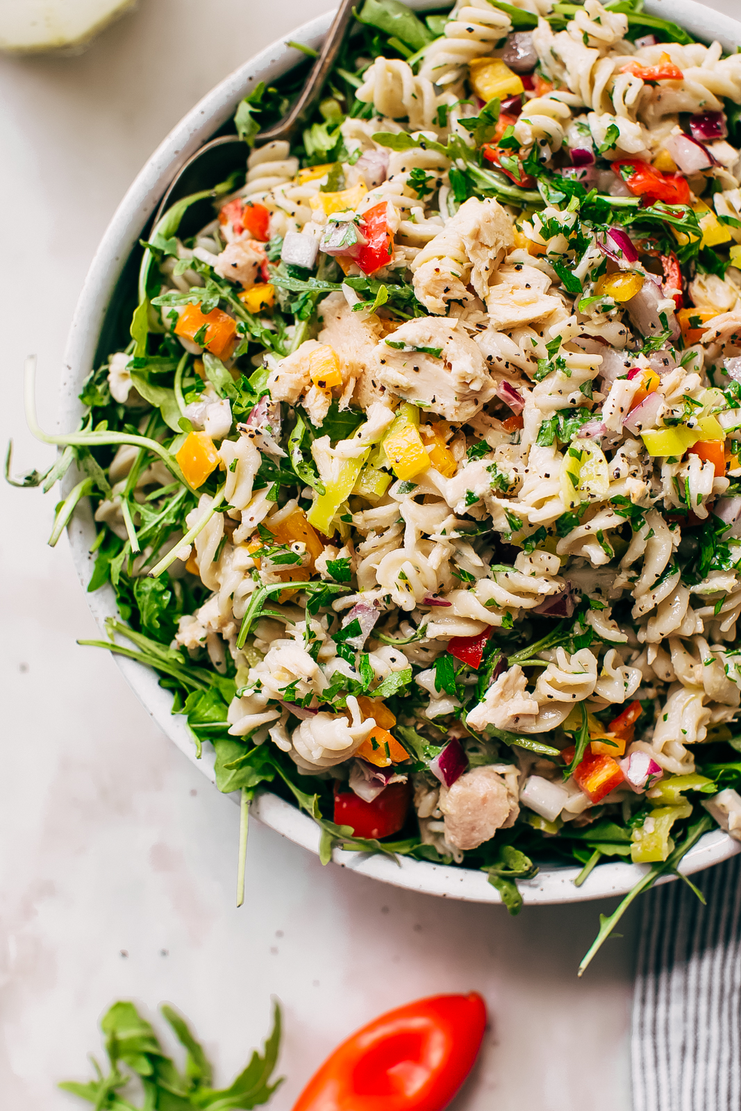 close up of salad in bowl topped with flaked tuna