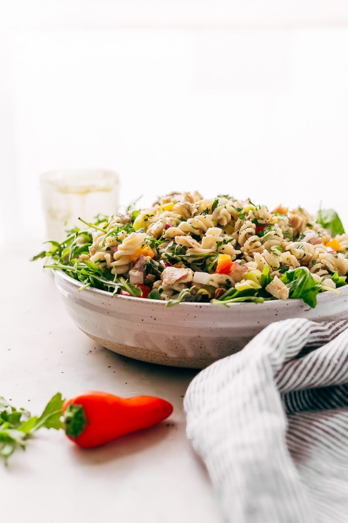 Quick Summer Tuna Pasta Salad - Learn how to make a quick summer tuna pasta salad that comes together in a flash! Loaded with tons of tender, peppery arugula, flakey tuna, and zesty pepperoncini. Dress it with the most addicting lemon ranch dressing. This is sure to become a go-to summer lunch recipe! #tunasalad #tunapastasalad #pastasalad #mealprep #healthylunch #saladrecipe | Littlespicejar.com