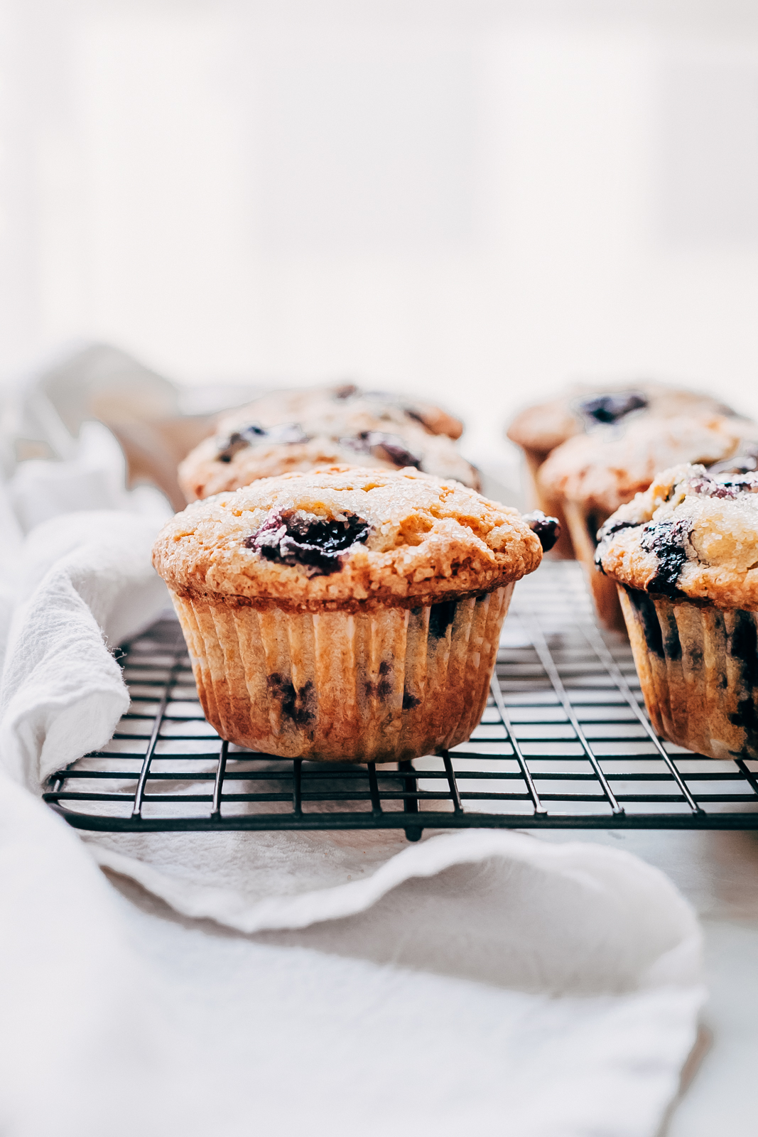gluten-free blueberry muffins in muffin liners on wire rack