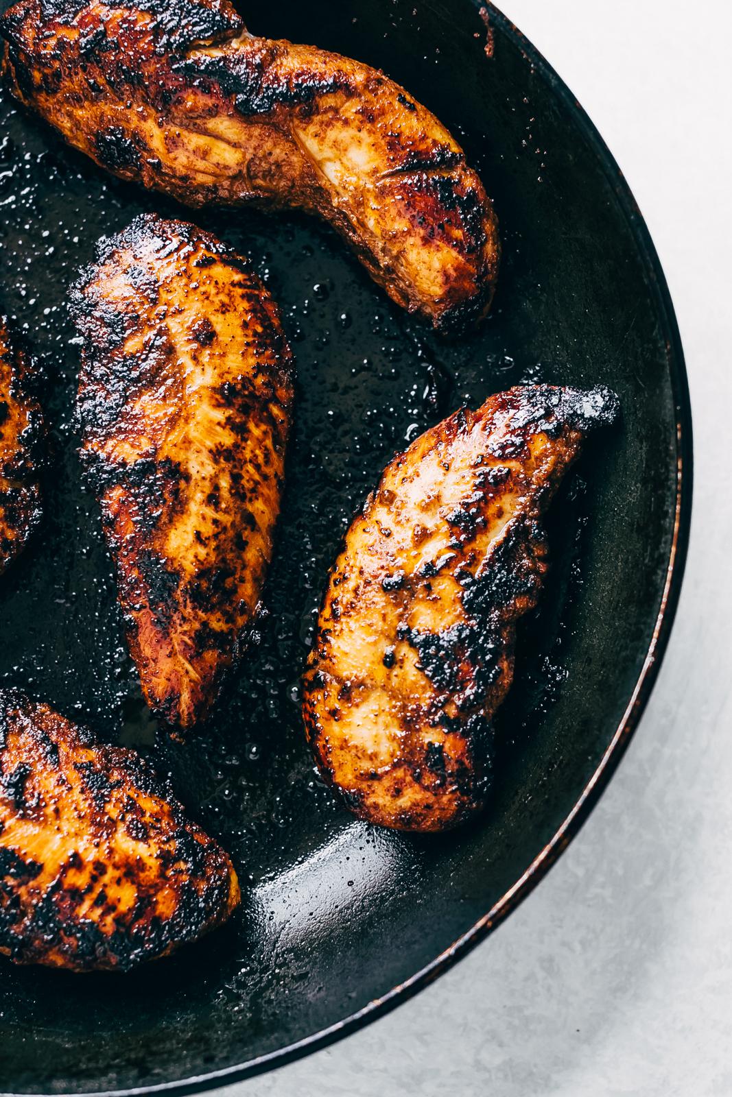 seared chicken tenders in black skillet