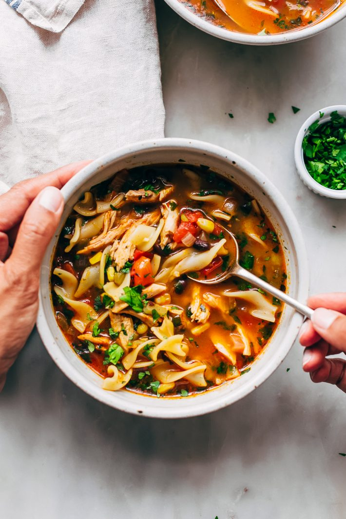 Mexican Chicken Noodle Soup - loaded with tender chicken, corn, beans, and of course, noodles! Ready in under 30 minutes! #chickennoodlesoup #southwesternchickennoodlesoup #soup #souprecipes   Littlespicejar.com