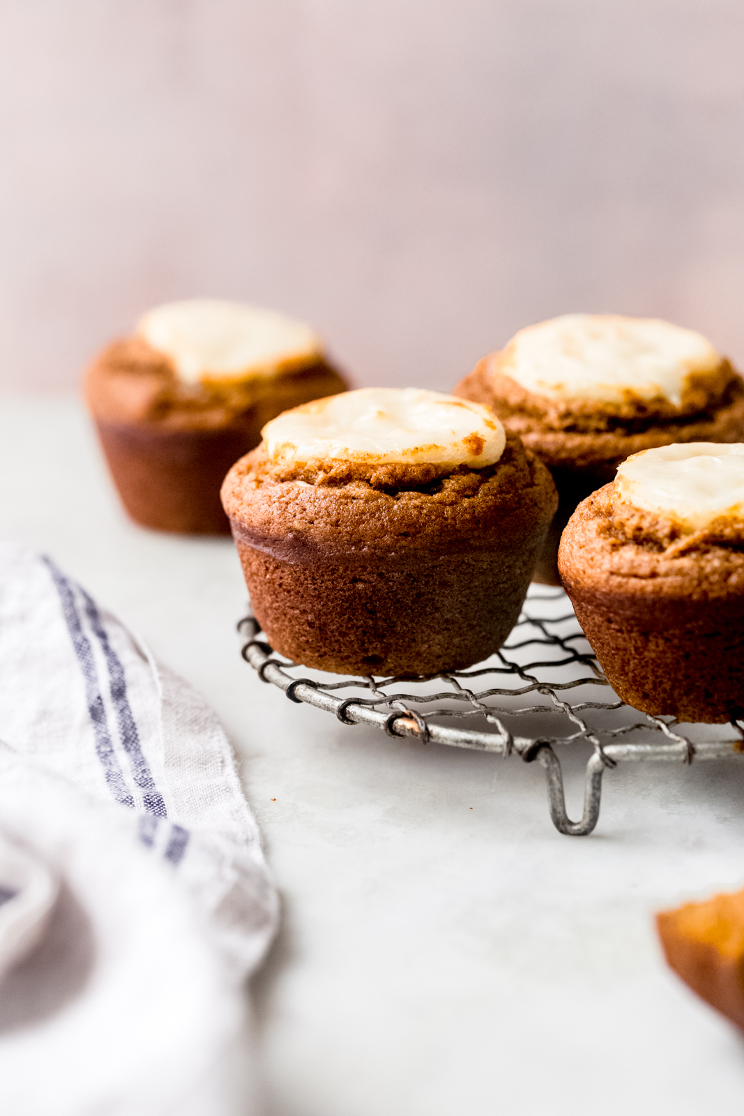 wire backing rack with prepared pumpkin muffins in white surface