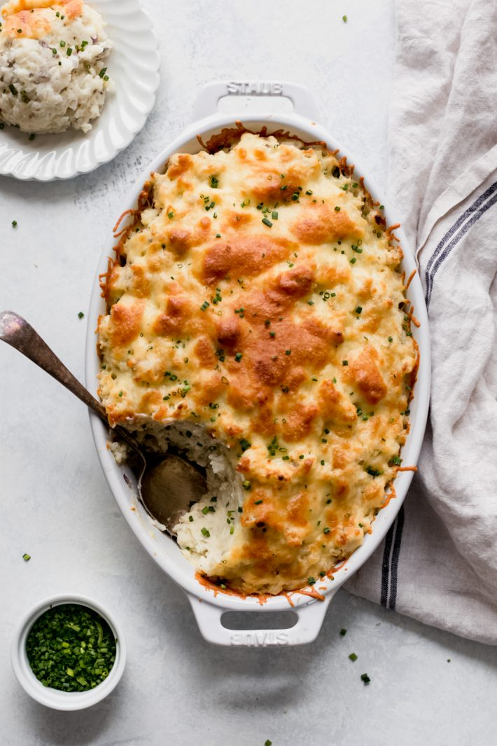 Twice Baked Potato Casserole (Potatoes Romanoff) - Turn regular old baked potatoes into something else special! This is sure to be a hit at Thanksgiving! #potatoesromanoff #twicebakedpotato #twicebakedpotatocasserole | Littlespicejar.com