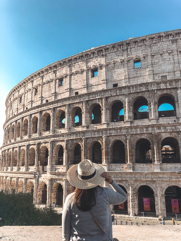 Girl standing in front of the Colosseum