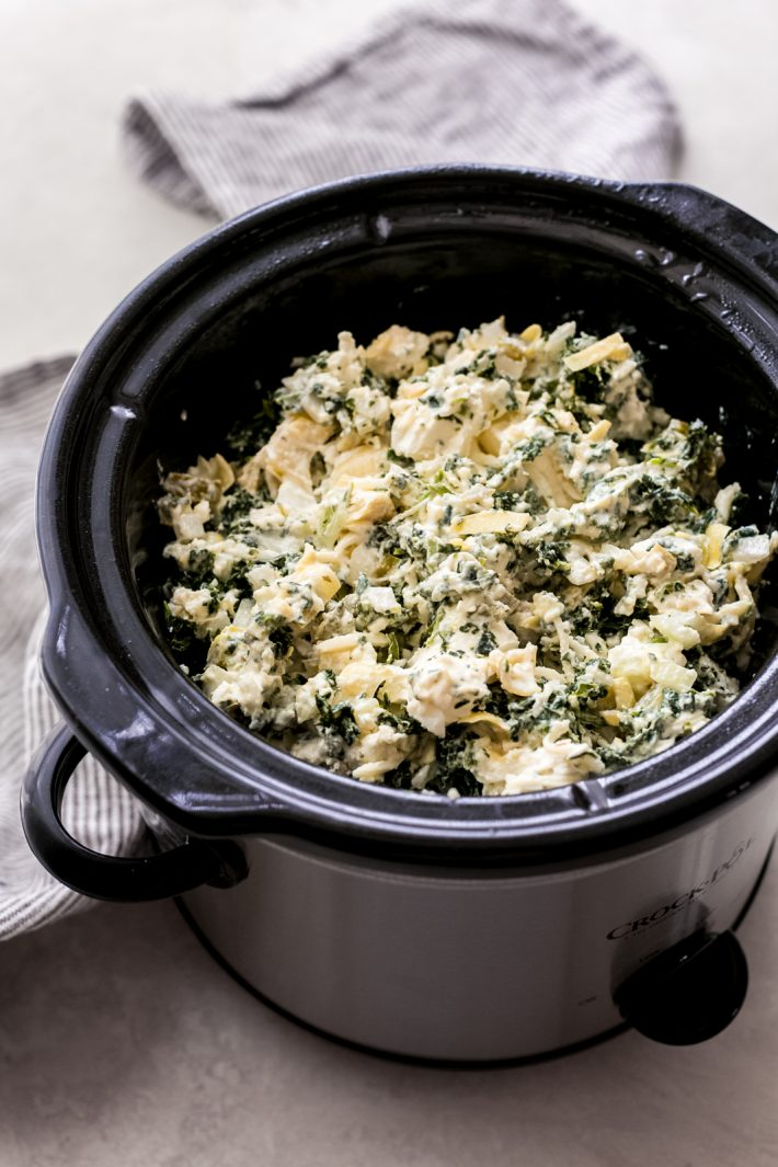 The Easiest Slow Cooker Spinach Artichoke Dip - Learn how to make the easiest dip EVER! Just toss everything into a slow cooker and let it do the work for you! #spinachartichokedip #hotspinachdip #hotdip #hotartichokedip #slowcookerspinachdip #slowcookerspinachartichokedip   Littlespicejar.com