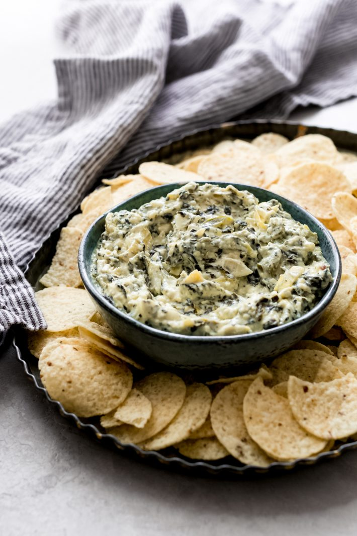 The Easiest Slow Cooker Spinach Artichoke Dip - Learn how to make the easiest dip EVER! Just toss everything into a slow cooker and let it do the work for you! #spinachartichokedip #hotspinachdip #hotdip #hotartichokedip #slowcookerspinachdip #slowcookerspinachartichokedip | Littlespicejar.com