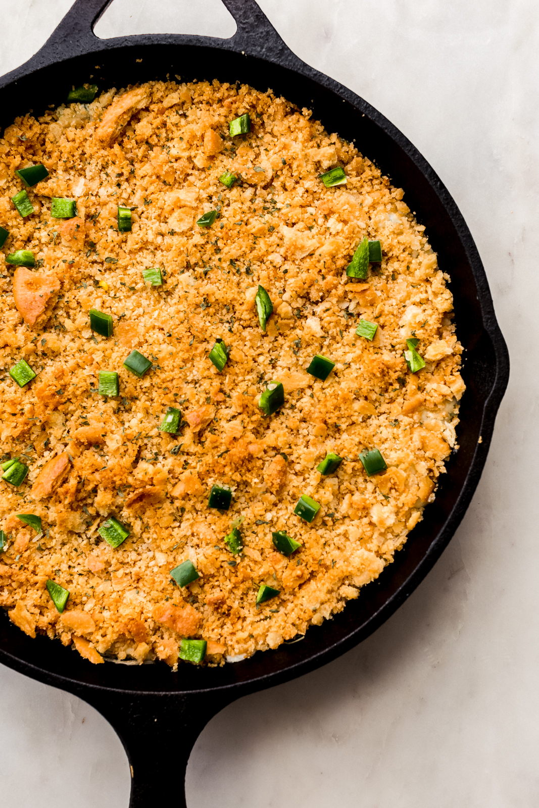 undisturbed jalapeno popper dip topped with cracker crumb fresh out of the oven