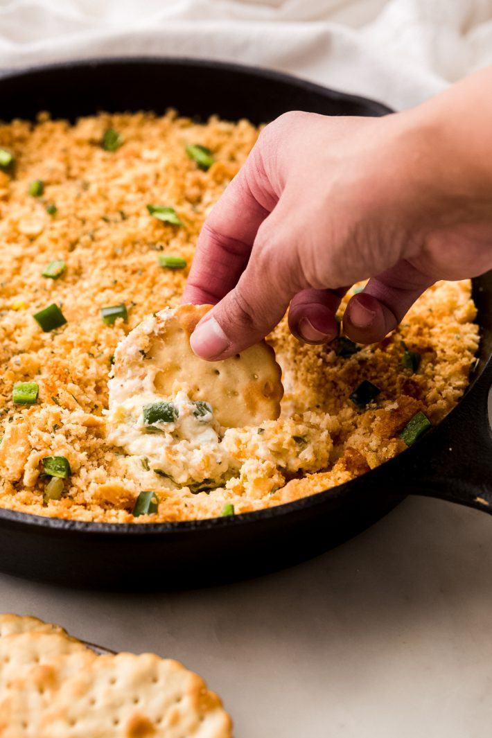 Addicting Jalapeno Popper Dip - My jalapeño popper dip is loaded with pickled and fresh jalapeños but doesn't bring a whole lot of heat, serve it with crackers or tortilla chips and watch the crowd go wild! #jalapenopopperdip #dip #superbowl #gameday #footballfood #holiday #dips   Littlespicejar.com