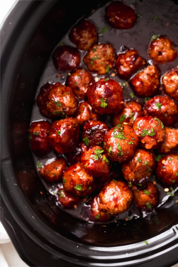 Slow Cooker Honey Chipotle Meatballs - the perfect football food! These meatballs are made with the most addicting honey chipotle sauce, it's sure to be a crowd pleaser! #superbowlrecipes #meatballs #slowcookermeatballs #chickenmeatballs #chickenrecipes #crockpot | Littlespicejar.com