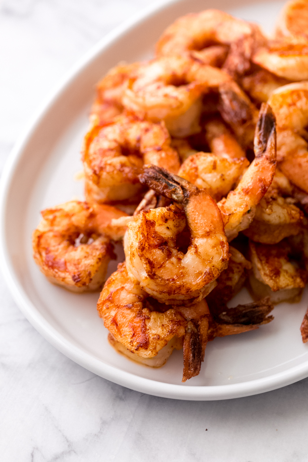 cooked Hawaiian shrimp on a white plate