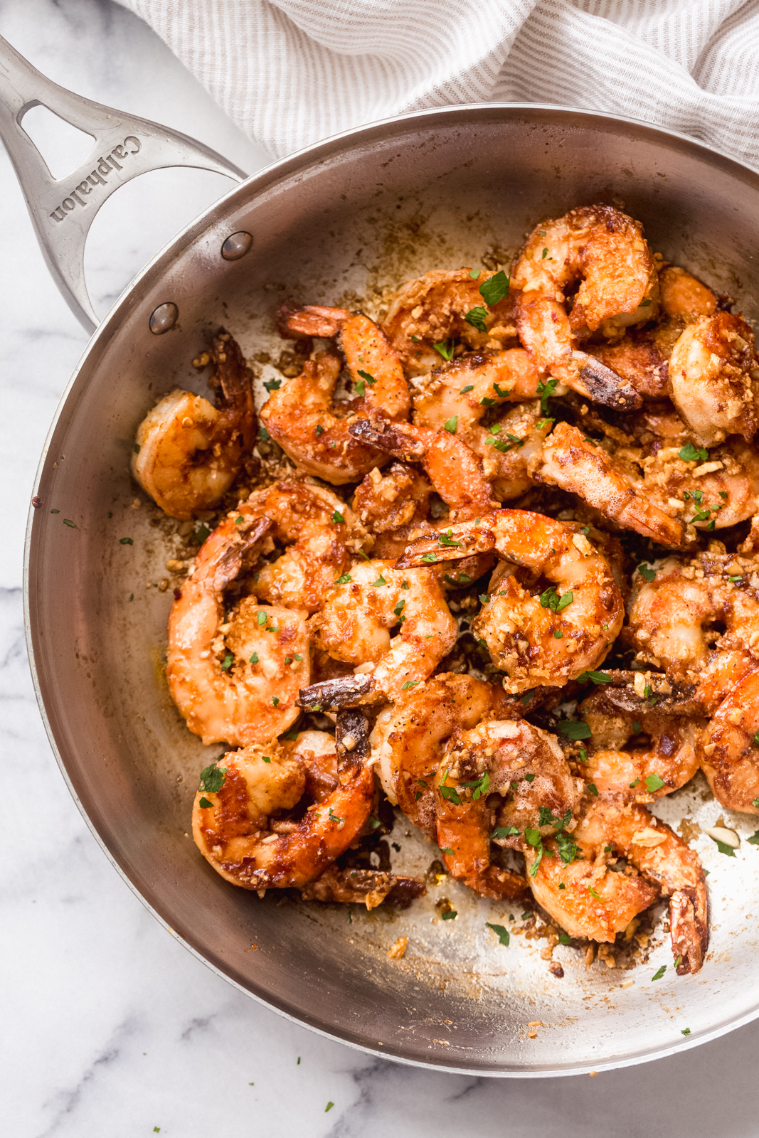 skillet with garlic butter tossed shrimp