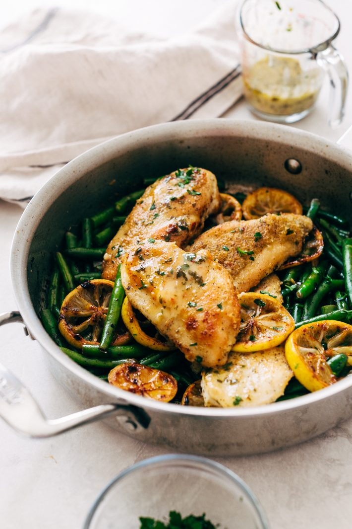 Skillet Garlic Lemon Butter Chicken - an easy chicken recipe with green beans and drizzled in a quick and easy garlic lemon butter sauce! #chickenrecipes #easydinner #lemongarlicchicken #chickendinner #skilletchicken | Littlespicejar.com
