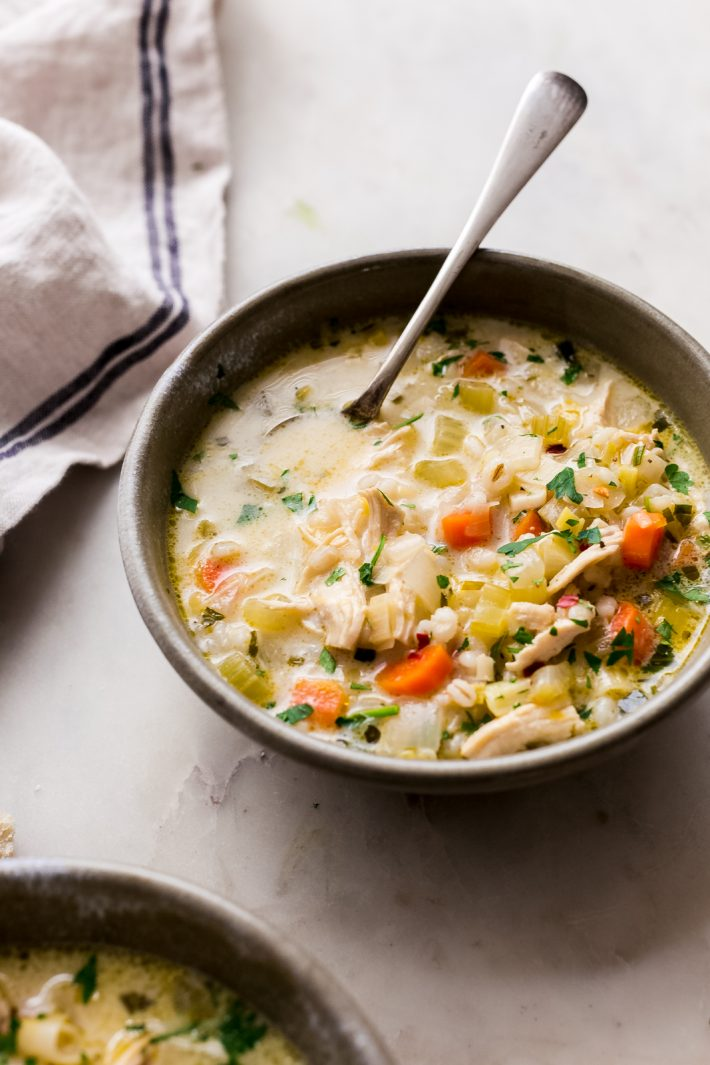 Winter Lemon Chicken Barley Soup - An irresistible creamy lemon chicken barley soup that has tons of veggies, tender barley and is hearty and comforting for chilly winter days! #chickenbarleysoup #chickensoup #soup #lemonsoup | Littlespicejar.com