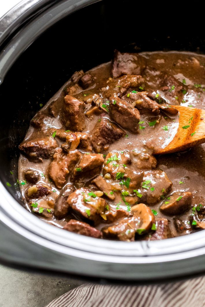 Ridiculously Tender Beef Tips with Mushroom Gravy - Easy beef tips in mushroom gravy that you can make in the instant pot or the slow cooker! This recipe is sure to be a hit with your entire family! #beeftips #beeftipsandmushroomgravy #beefstew #instanpotrecipe #instantpot #slowcooker #slowcookerbeeftips | Littlespicejar.com