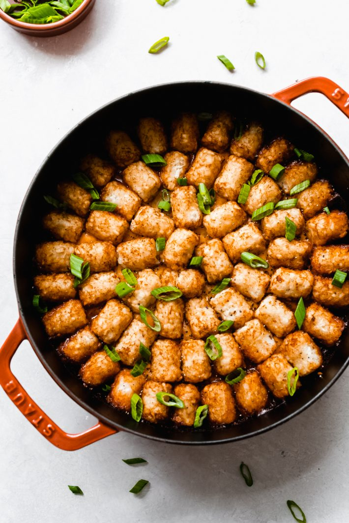 cast iron dish with tater tot casserole