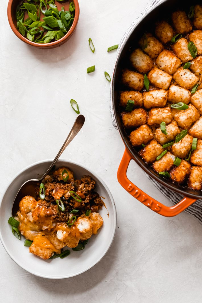 Tater Tot Chili Cheese Hotdish - A homemade chili with beans, topped with shredded cheese and tater tots and it all comes together in ONE pot! #chilicheesehotdish #hotdish #onepotmeals #recipes #dinnerrecipes #easyrecipes   Littlespicejar.com