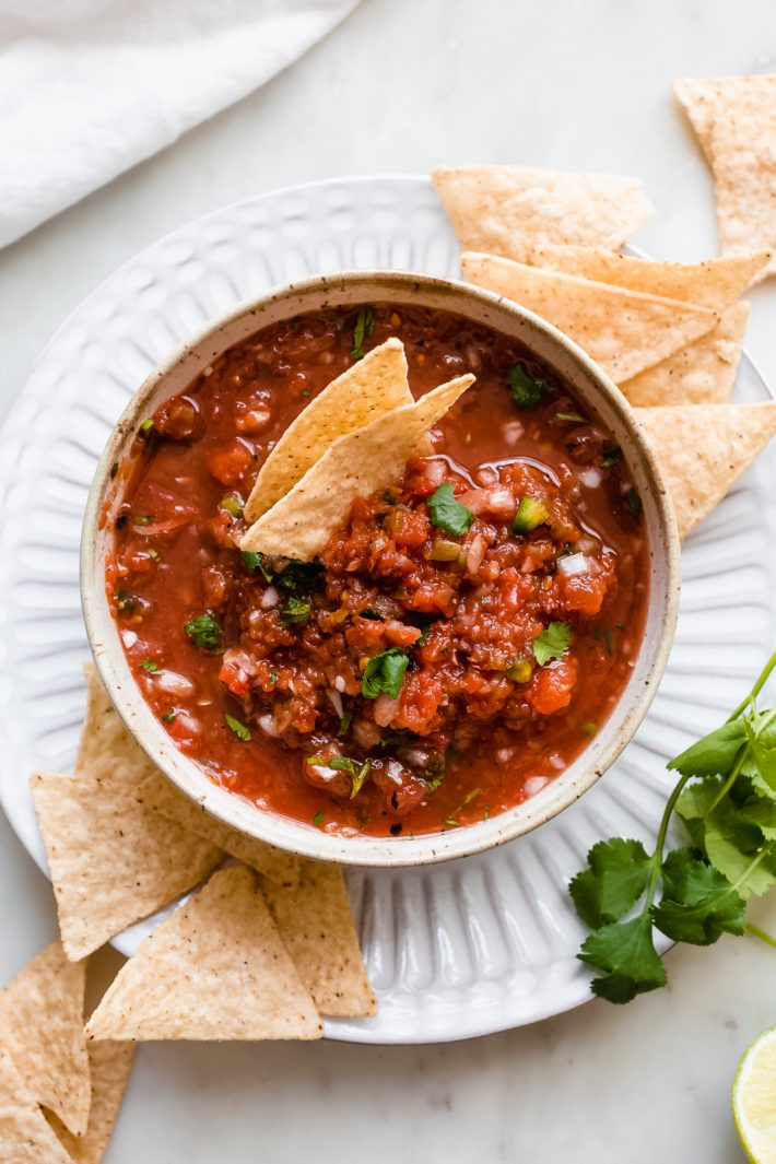 5-Minute Blender Salsa (Restaurant Style) - The perfect recipe to make for Cinco de Mayo and its really easy! Just toss it all in the blender or food processor! #blendersalsa #salsaroja #5minutesalsa #salsarecipe #restaurantstylesalsa #homemadesalsa | Littlespicejar.com