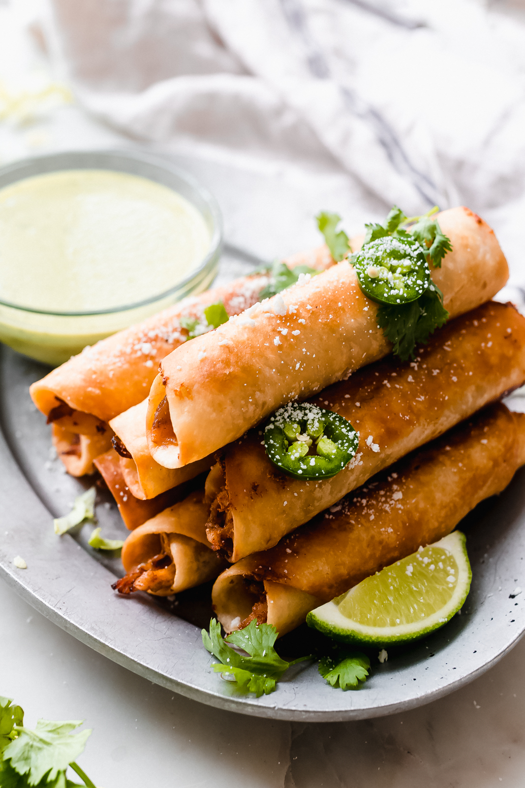 close up of fried stack of taquitos