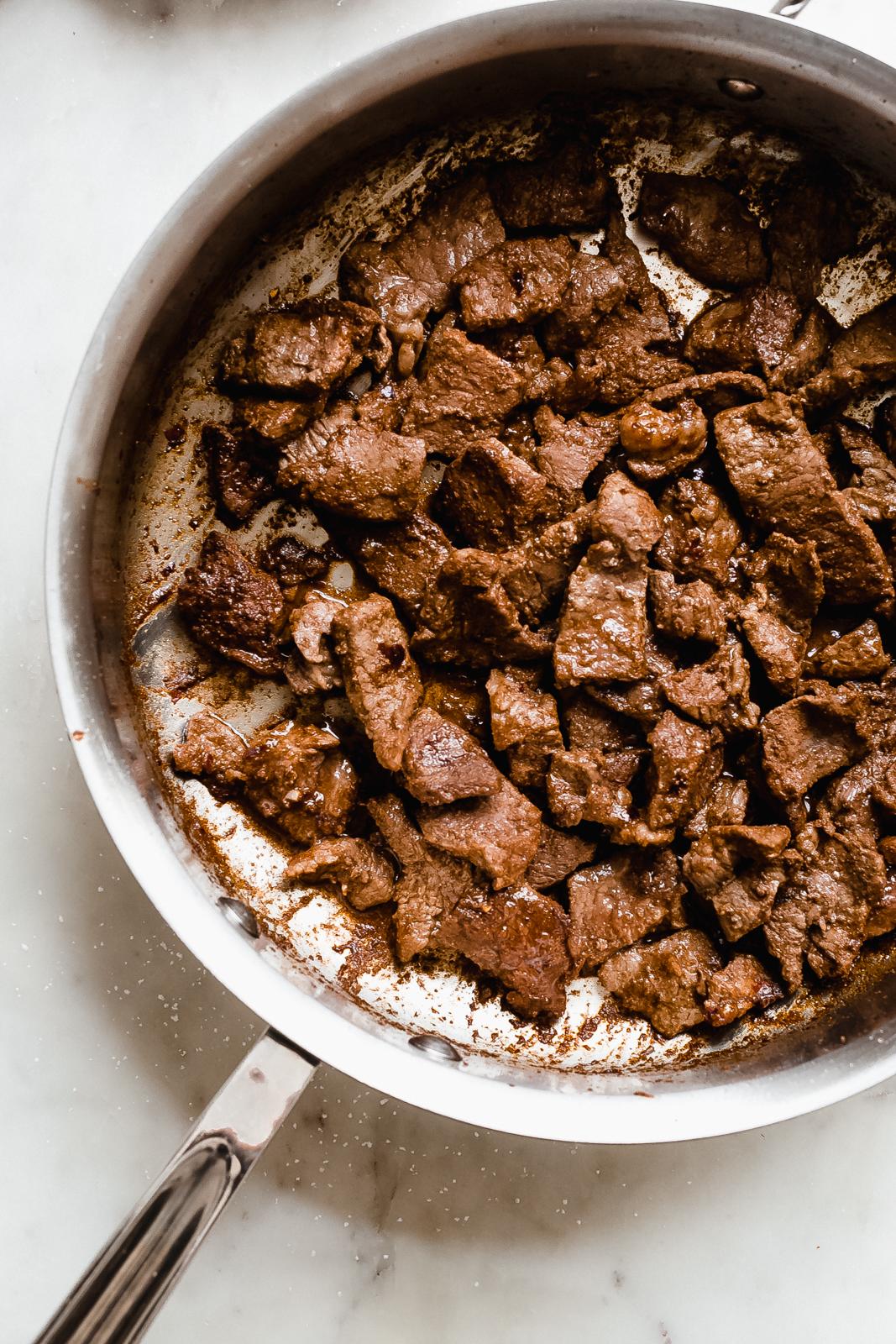 seared steak in pan
