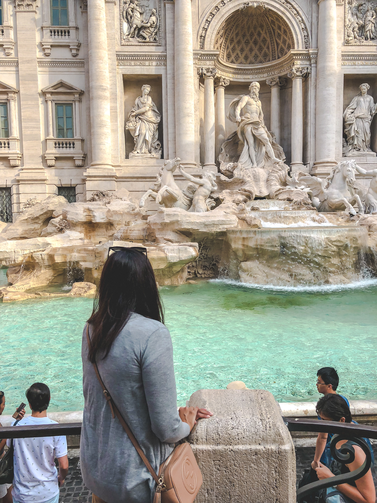 me standing and looking at the trevi fountain