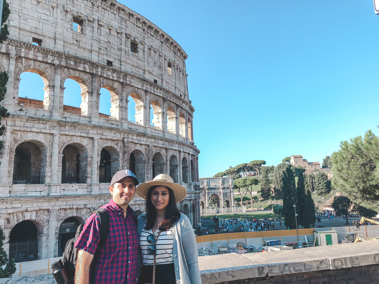 early morning shot of hubby and me in front of the colosseum