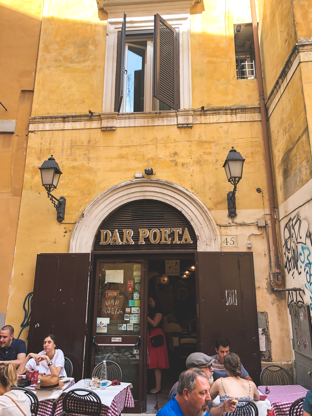 outside the iconic Dar Poeta pizza shop in Trastevere
