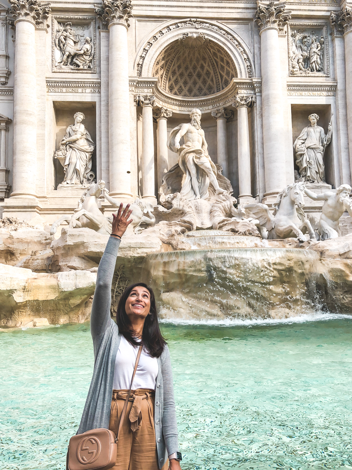 me throwing a penny into the Trevi Fountain