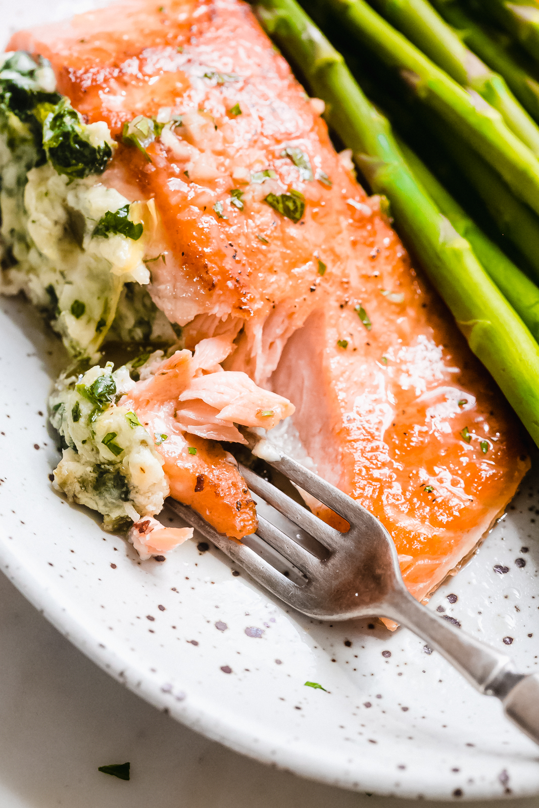 stuffed salmon filet being flaked with a fork