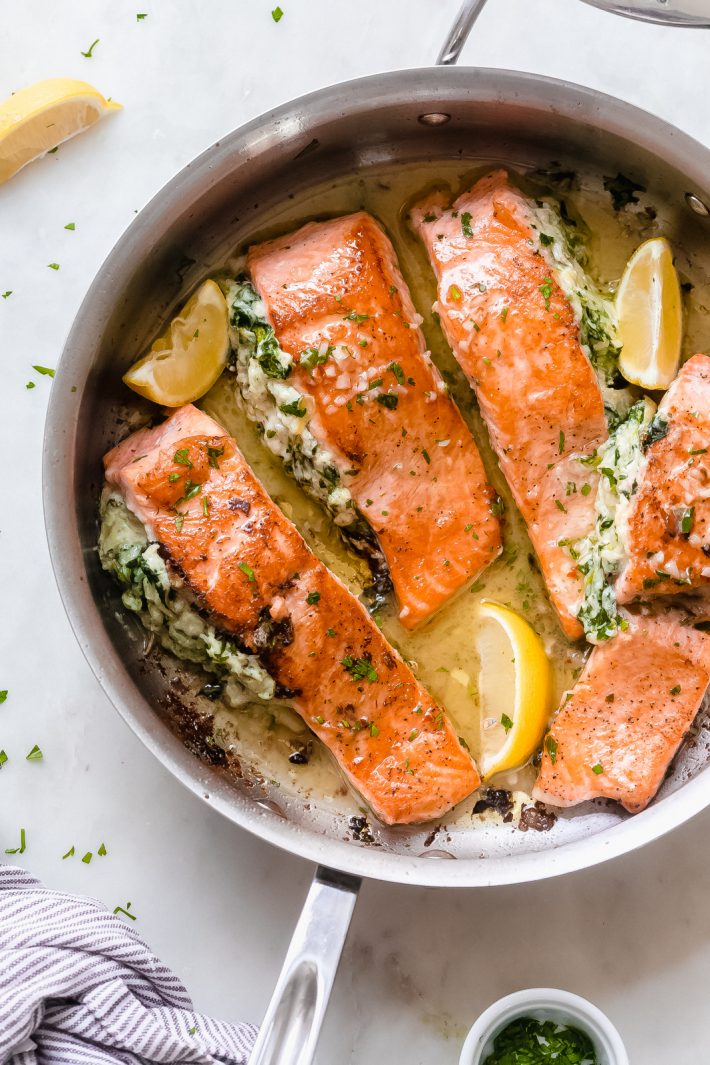Creamy Spinach Artichoke Stuffed Salmon with Lemon Butter Sauce - An easy yet fancy dinner that's quick enough to prepare for weeknights and fancy enough to serve company! The lemon butter sauce is truly to-die-for! #stuffedsalmon #searedsalmon #salmonrecipes #ketorecipes #keto #ketodinner #salmonrecipes | Littlespicejar.com