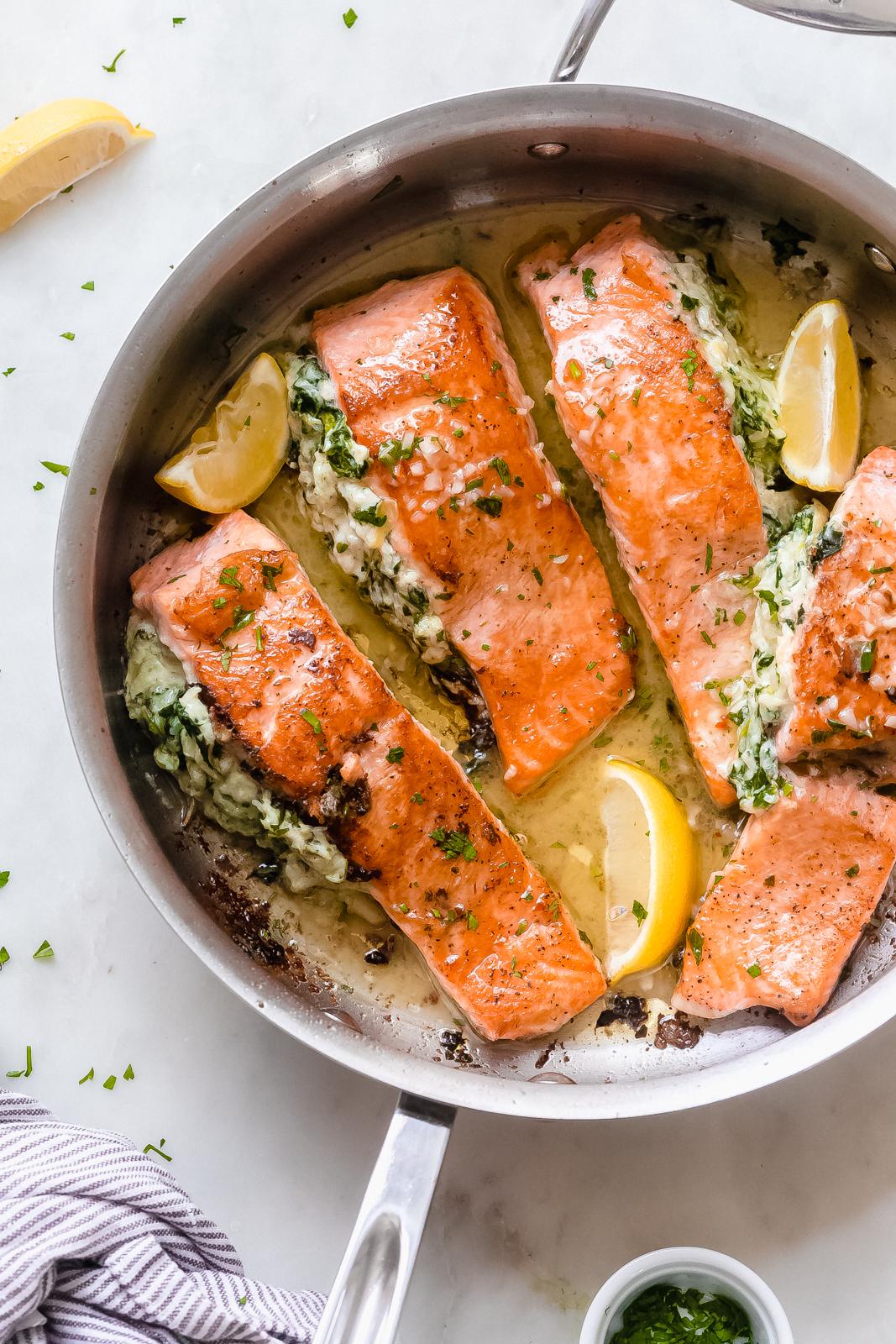 prepared seared salmon filets in stainless steel sauce pan