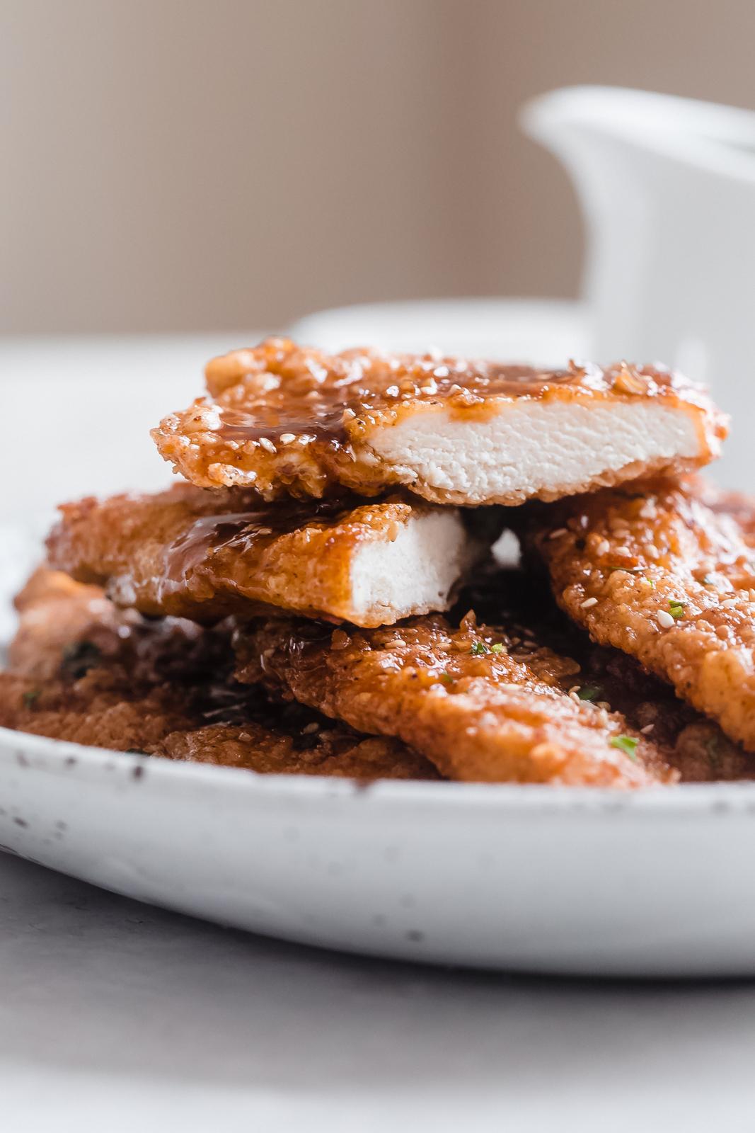 crispy honey garlic chicken sliced to show cooked chicken inside