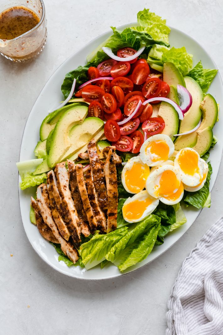platter with individual ingredients for chicken Cobb Salad