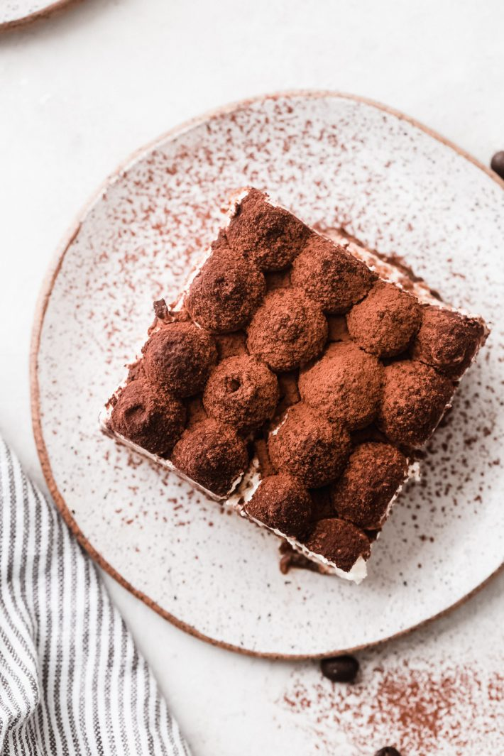 The Easiest Eggless Tiramisu: Learn how to make the easiest eggless tiramisu! Tiramisu takes just 15 minutes of hands-on work and requires no cooking or baking. Eggless tiramisu is the perfect summer dessert! #tiramisu #egglesstiramisu #tiramisudessert #nobakedessert #summerdessert | Littlespicejar.com
