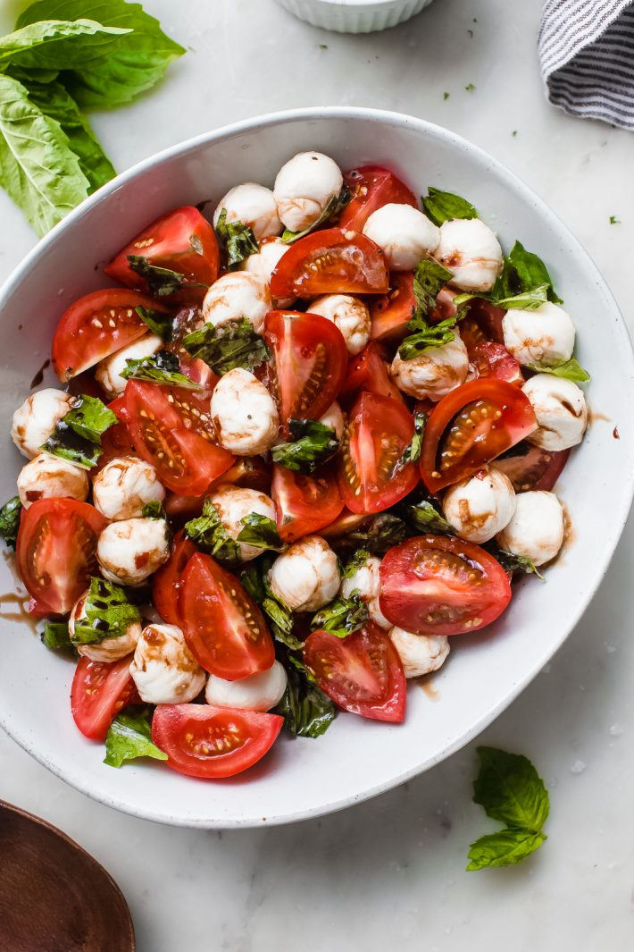Marinated Mozzarella Tomato Salad - an easy salad that is loaded with marinated mozzarella, fresh tomatoes, basil. This is the PERFECT SUMMER SALAD RECIPE! #summer #mozzarellasalad #tomatosalad #tomatobasilsalad #capresesalad #saladrecipes | Littlespicejar.com