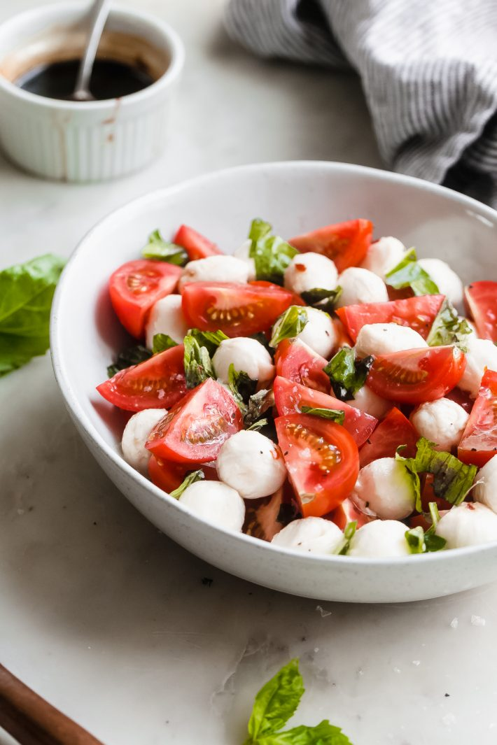 Marinated Mozzarella Tomato Salad - an easy salad that is loaded with marinated mozzarella, fresh tomatoes, basil. This is the PERFECT SUMMER SALAD RECIPE! #summer #mozzarellasalad #tomatosalad #tomatobasilsalad #capresesalad #saladrecipes | Littlespicejar.com