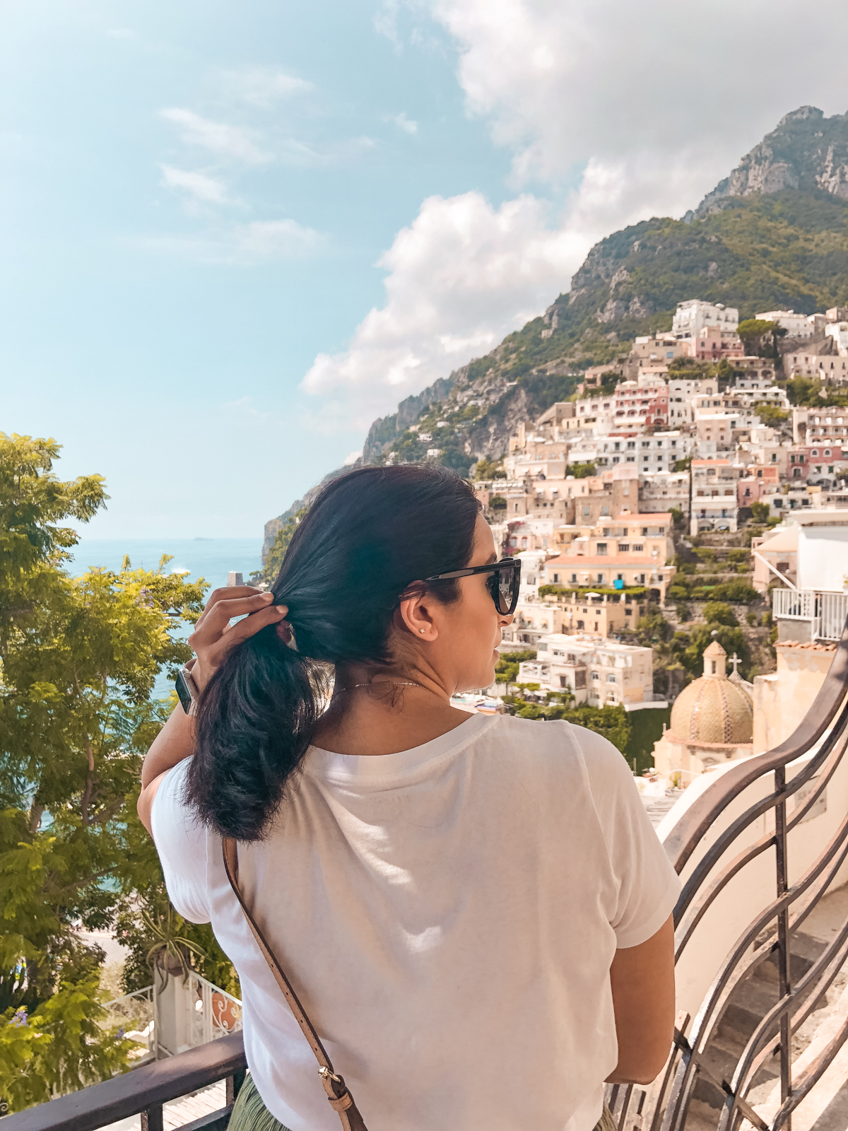 me looking out at the city of Positano from the top