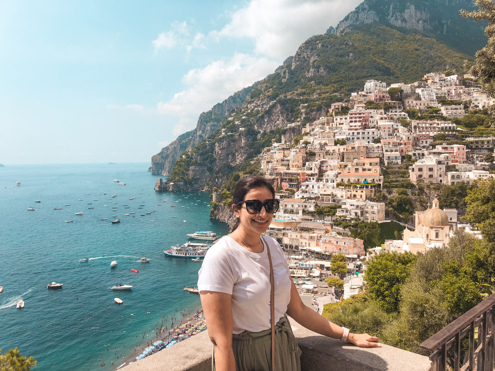 picture of me with iconic Positano houses and water in the background