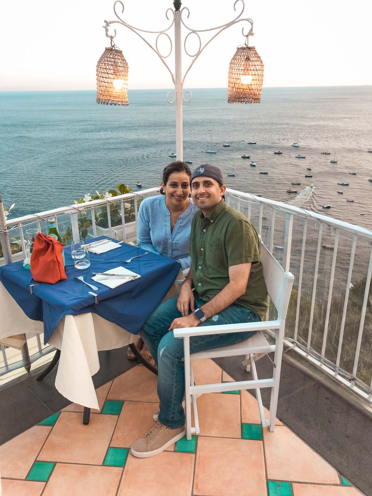 picture of hubby and me at the corner of restaurant by the water